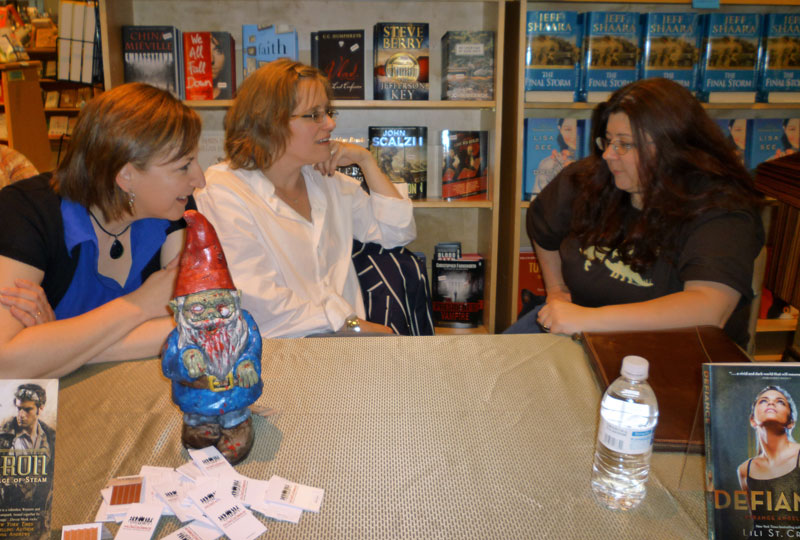 Three of four authors talking. Photo by The Andrews' Kid 2